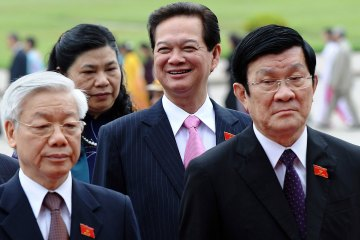 HOANG DINH NAM / AFP / GETTYVietnam's Prime Minister Nguyen Tan Dung (C) smiles as he walks behind Vietnamese Communist Party's Secretary General Nguyen Phu Trong (L) and President Truong Tan Sang (R) toward the late president Ho Chi Minh's mausoleum prior to the opening of the National Assembly's second annual session in Hanoi on October 22, 2012.