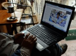 A man reads online news with his laptop at a coffee shop in downtown Hanoi on January 15, 2013. Campaigners urged the UN Human Rights Council Friday to take Vietnam to task over its jailing of dozens of cyber-dissidents, claiming Hanoi was in breach of international law.